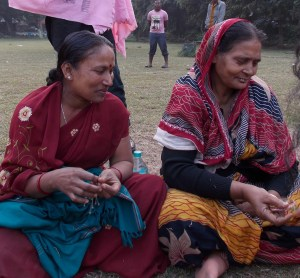 Salena Begum, left, in a maroon sari, still works in prostitution as she saves money to launch a laundry business with Asma Bibi, right, and other women. Photo by Barbara Borst