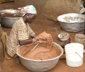 Once the nuts have been roasted, crushed and boiled, women knead the mixture for hours as it cools in order to bring the butter to the surface.