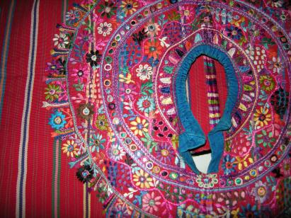 Embroidery surrounds the collar of a traditional Maya shirt.