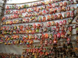 Masks in the market at Chichicastenango in Guatemala. Photo by Barbara Borst
