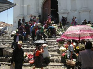 At Santo Tomas, a Catholic church built atop a Maya altar in Chichicastenango, worshipers use symbols of both cultures. Photo by Barbara Borst
