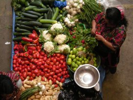 A vegetable seller in the Chichicastenango market. Photos by Barbara Borst