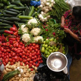 A vegetable seller in the Chichicastenango market. Photos by Barbara Borst