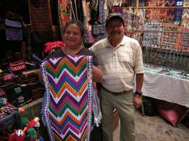 A wife and husband display wares in their stall at the Chichicastenango market.