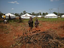 Two boys pause among the tents for new refugees from Burundi in Nyarugusu camp, Tanzania. Photo by Barbara Borst