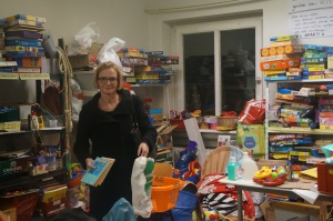 Ruth Stephan, an administrator at Karlsruhe Institute of Technology and lead organizer of Refugee Aid at KIT, in the supply room at the shelter for asylum seekers on the university's eastern campus. Photo by Kavitha Surana