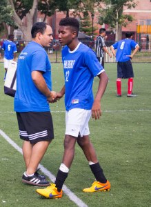 Elvis Garcia Callejas, coach and Catholic Charities migration counselor, switches a young player out of the game. Photo by Katie Schlechter