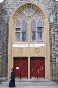 A man walks by Medhani Alem Church in Bronx, New York City. Photo by Ayenat Mersie