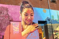 """The """"Our Journey Blossoms"""" mural covers the wall of the immigrant organization Mixteca's building in Sunset Park. Photo by Nidia Bautista"""